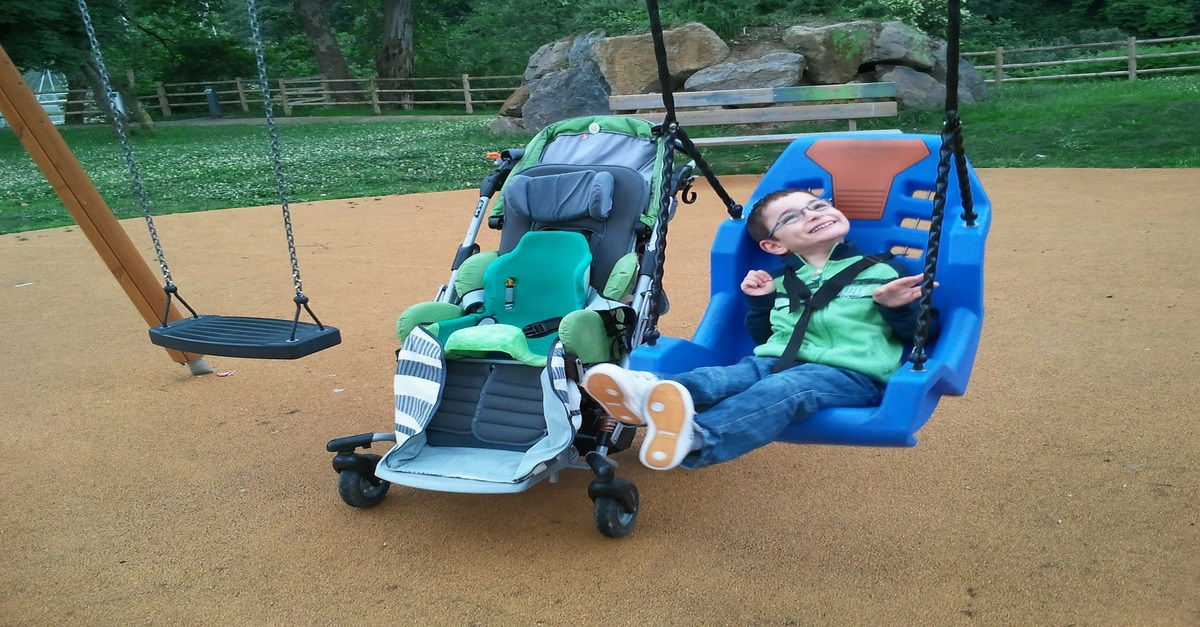 A child with cerebral palsy on a swing