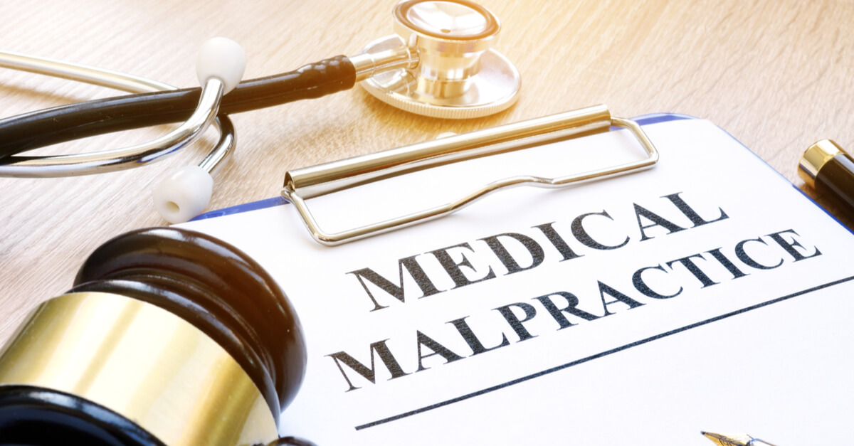 A piece of paper with the words medical malpractice on it